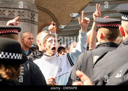 Right wing extremists from the English Defence League (EDL) face off outside Liverpool street station London - Stock Photo