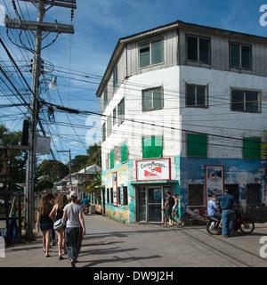 People walking on the road in a town Utila Island Bay Islands Honduras - Stock Photo