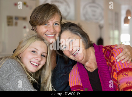 Portrait of happy three generation females at home - Stock Photo