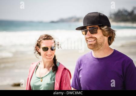 Young couple walking, Laguna Beach, California, USA - Stock Photo