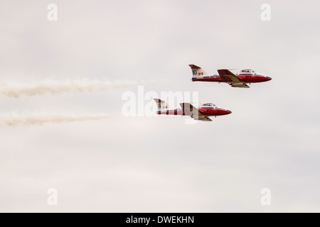 Two Canadian Snowbird aircraft flying in formation. - Stock Photo