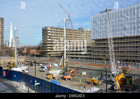 Scaffolding for demolition and foundations for re-development work both under way on part of the obsolete Heygate - Stock Photo
