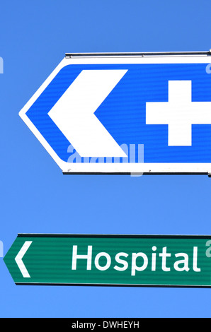 Hospital road sign with text against blue sky. concept photo of health and medical care. - Stock Photo