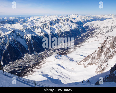 View from Aiguille du Midi above valley with snow on the French Alps. Chamonix-Mont-Blanc, Haute Savoie, Rhone-Alpes, - Stock Photo