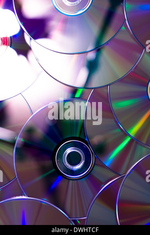 many CDs. Abstract background of rainbow discs - Stock Photo