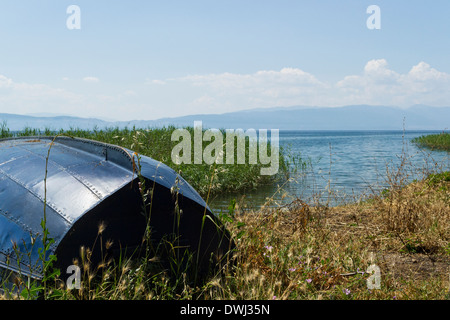 Small boat on the shore of Lake Ohrid, Macedonia - Stock Photo