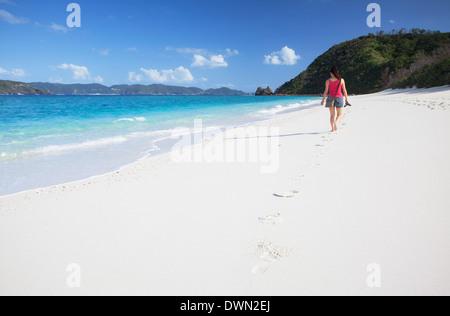 Woman walking on Nishibama Beach, Aka Island, Kerama Islands, Okinawa, Japan, Asia - Stock Photo