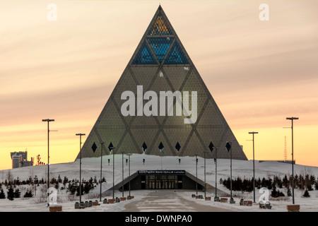 Pyramid of Peace and Harmony in the evening, Astana, Kazakhstan - Stock Photo