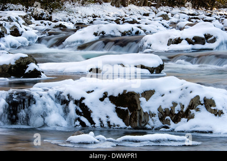 Snow and Ice on the Little Pigeon River in the Great Smoky Mountains National Park in Tennessee - Stock Photo