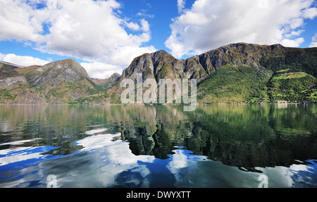 Reflection of a scenic fjords in Norway - Stock Photo