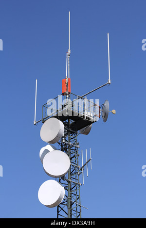 Various antennas for mobile communication in an iron tower - Stock Photo