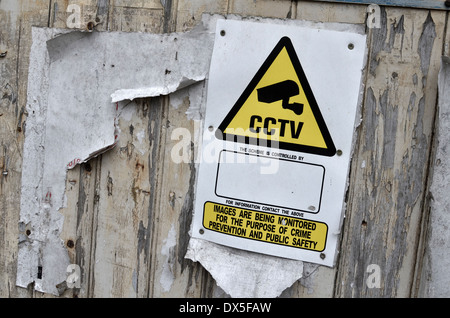 CCTV warning sign on industrial premises. - Stock Photo