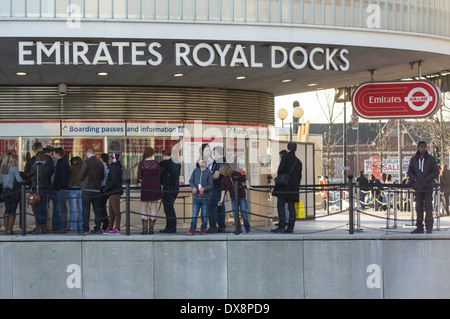 Passengers wait in queue at the Royal Docks cable car terminal, London England United Kingdom UK - Stock Photo