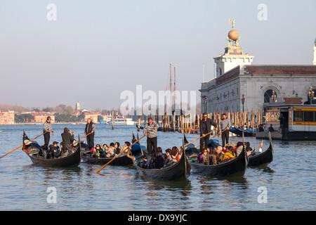 A tour in gondola in Venice - Stock Photo