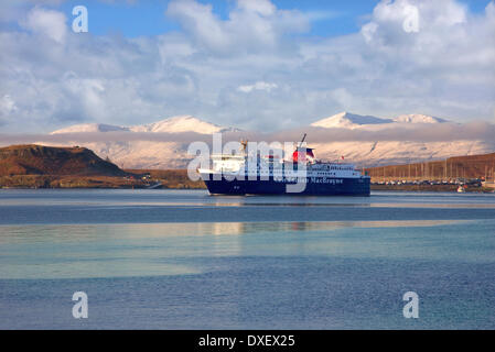 Winter view of the MV Isle of Mull ferry in Oban Bay, with the islands of Kerrera and Mull in view.Oban, Argyll. - Stock Photo