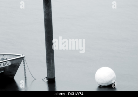 Rowing boat long time exposed - Stock Photo