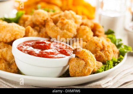 Organic Breaded Popcorn Shrimp with Cocktail Sauce - Stock Photo
