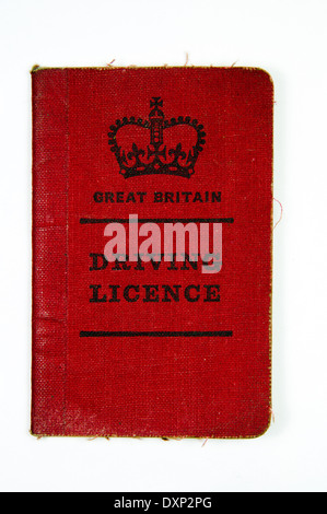 Old red British driving license - Stock Photo