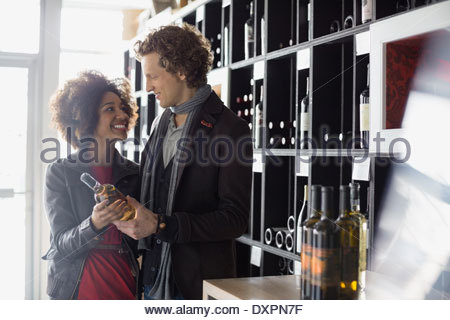 Couple shopping in wine store - Stock Photo