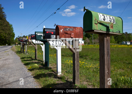 Rural mailboxes lined up along country road - Stock Photo