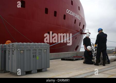 Perth, Australia . 30th Mar, 2014. Workers assemble equipments to be loaded on Australian Defence Vessel Ocean Shield - Stock Photo