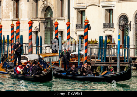 Tourists Taking A Gondola Ride, The Grand Canal, Venice, Italy - Stock Photo