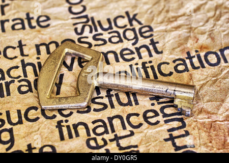 Finance text and golden key - Stock Photo