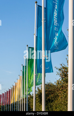 Olympic Flags flying on the road to Eton Dorney, Berkshire, England, GB, UK. - Stock Photo