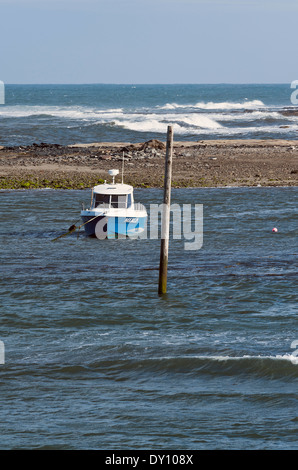 Small Cabin Cruiser Moored in Sheltered Water Outside Seahouses Harbour Northumberland England United Kingdom UK - Stock Photo