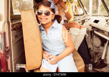 Girl wearing sunglasses in car - Stock Photo