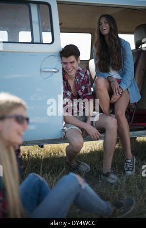 Friends in campervan - Stock Photo