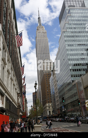 American flags on Macy's department store and Empire State Building Manhattan New York USA United States - Stock Photo