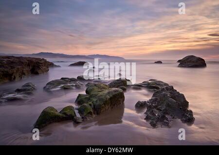 Rocks at sunset, Pacific City, Oregon, United States of America, North America - Stock Photo