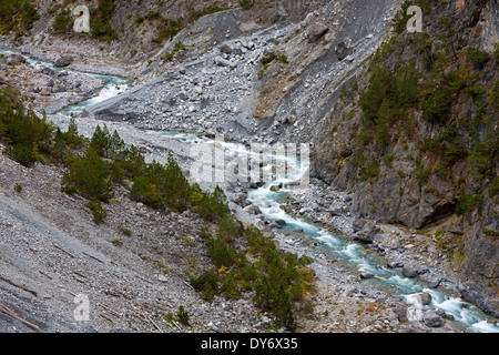 Mountain torrent running in Clemgia gorge in the mountains of the Swiss National Park at Graubünden / Grisons, Alps, - Stock Photo