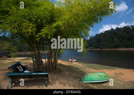 The serene lake at Gavi and beautiful Periyar reserve in the backdrop - Stock Photo
