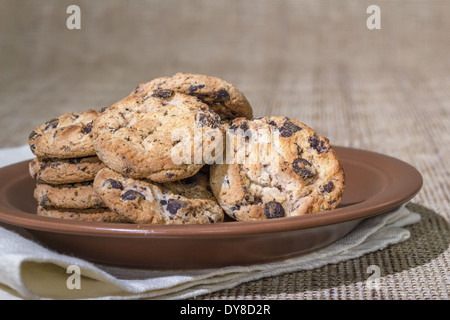 Oatmeal cookies with raisins on a brown platter - Stock Photo