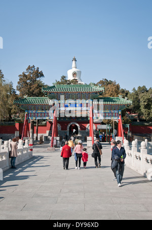 Yong'an bridge with Bai Ta stupa on background in Yong'An Temple (Temple of Everlasting Peace) in Beihai Park in - Stock Photo