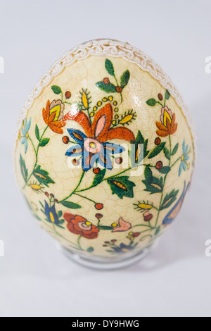 Easter egg decorated with flowers made by decoupage technique on light background - Stock Photo