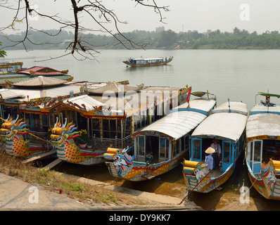 Sampans  used for the Perfumed river  boat tours ln front of the  Thien Mu Pagoda  on the Perfumed river Hue , Vietnam - Stock Photo
