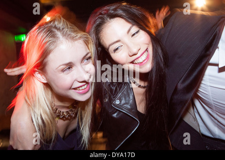 Friends out at night having fun - Stock Photo