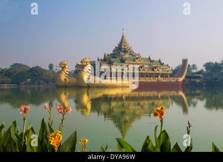 Myanmar Burma Asia Paya Yangon Rangoon Kandawgyi Floating architecture colourful famous flowers image lake reflection - Stock Photo