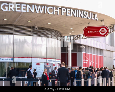 Passengers queuing to buy tickets for the Emirates Air-Line cable cars at the Greenwich Peninsula station in south - Stock Photo