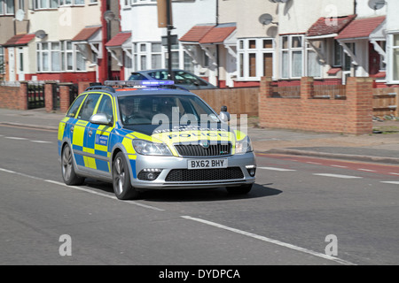 A Metropolitan Police ANPR (Automatic number plate recognition) car with flashing lights in Hanwell, London, UK. - Stock Photo