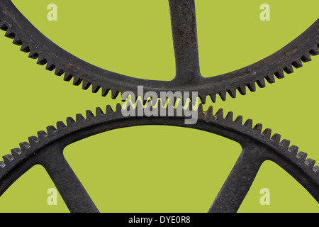 Two old Metal rusty Cog Gears on a green background - Stock Photo