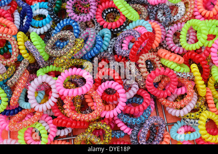 colourful bracelets on street market stall - Stock Photo