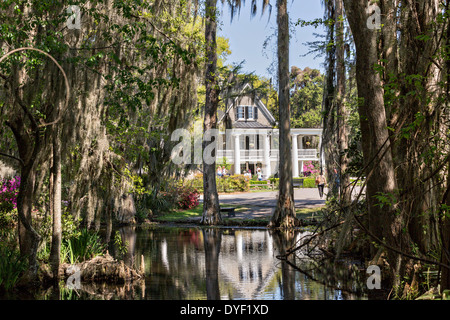 Plantation house seen from the garden lake at Magnolia Plantation April 10, 2014 in Charleston, SC. - Stock Photo