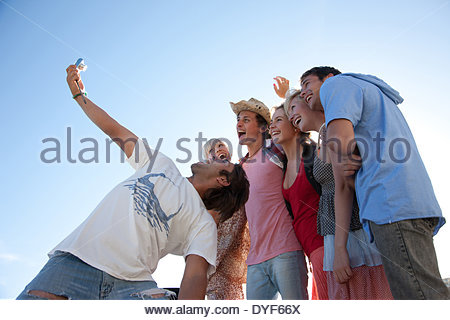 Man digital camera taking photograph friends - Stock Photo
