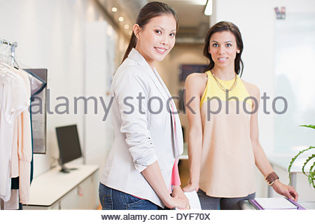 Portrait of fashion designers in office - Stock Photo
