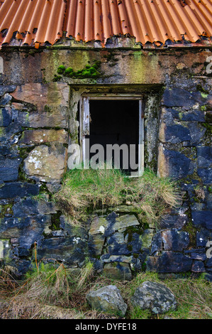 Window detail of abandoned croft house near Lochmaddy, North Uist, Outer Hebrides, Scotland - Stock Photo