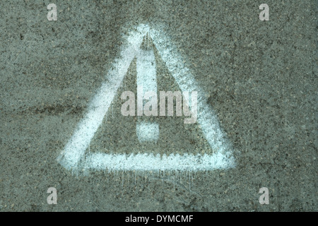 symbol of danger on the wall - Stock Photo